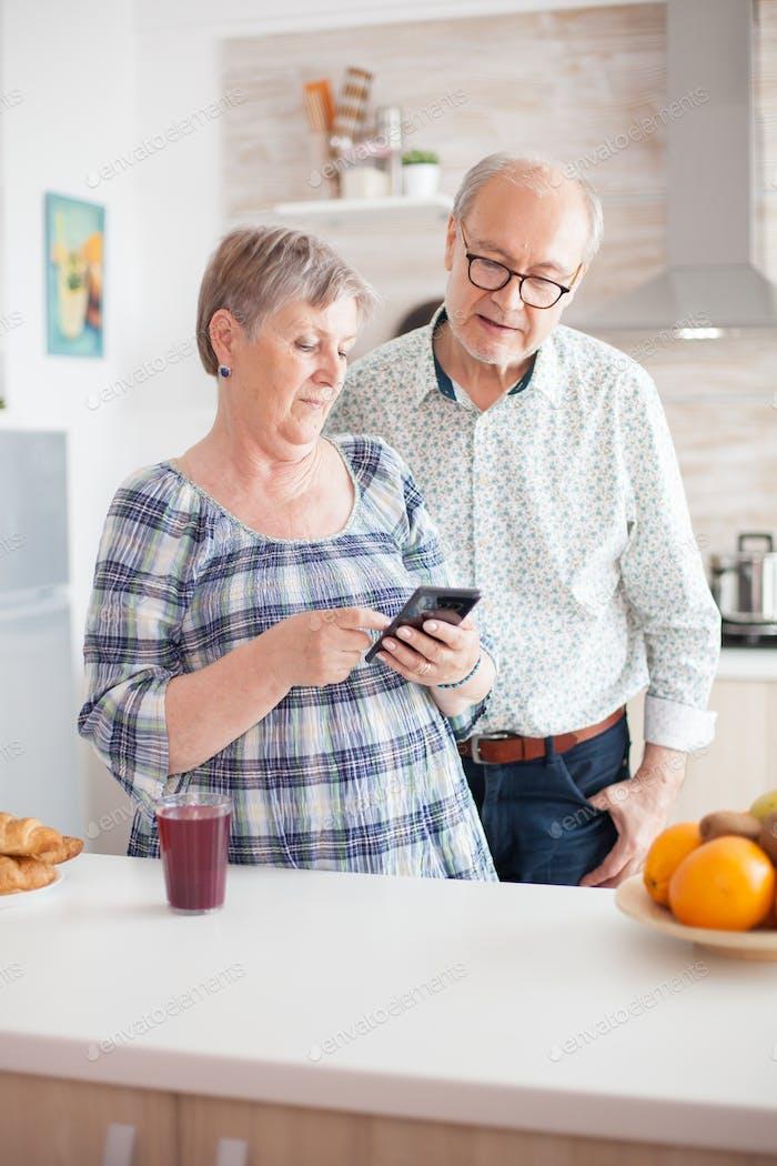 Elderly couple looking on internet
