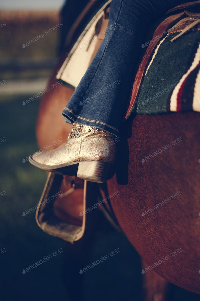 Little girl riding a horse