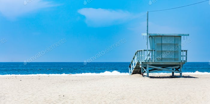 Lifeguard hut on Santa Monica beach. Pacific ocean coastline Los Angeles USA.
