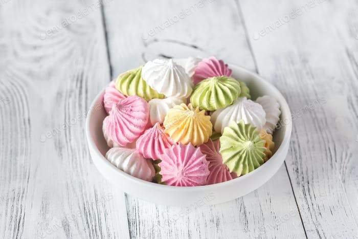 Bowl of colored meringues