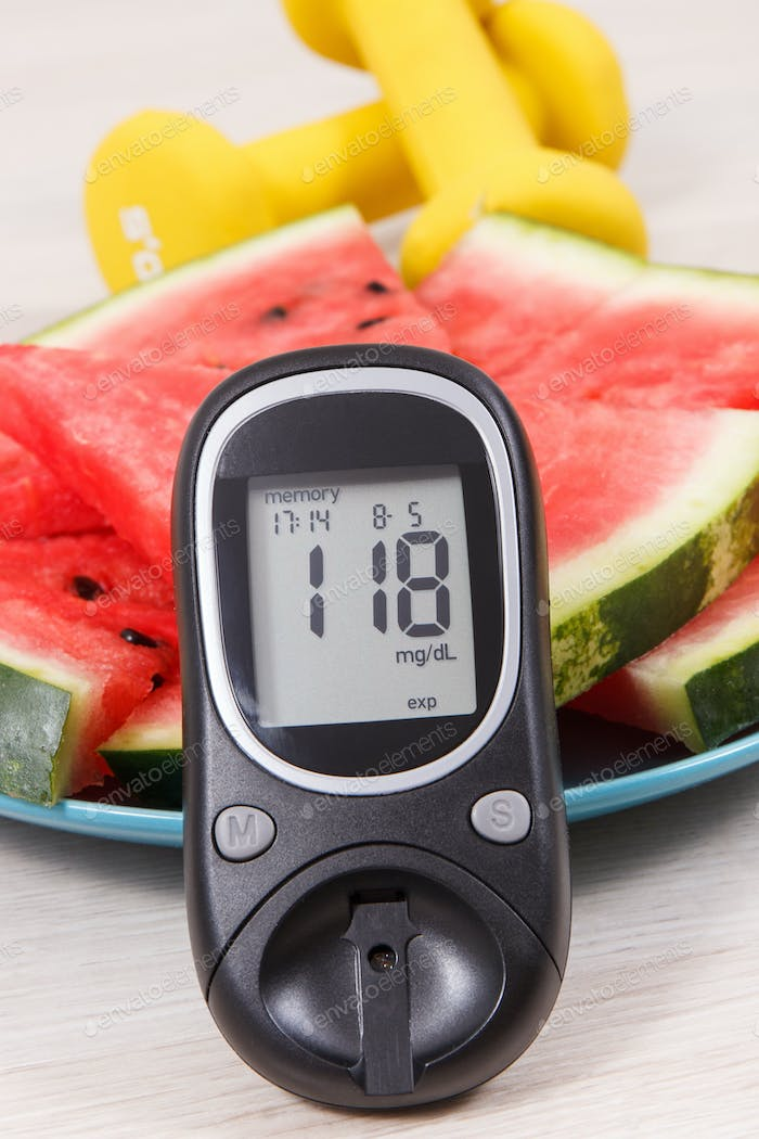 Watermelon, glucometer with result sugar level and dumbbells, healthy lifestyles concept