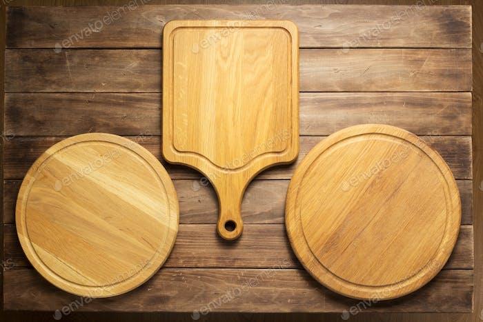 Panel de cortar pizza en tablero de De madera de Fondo tablón