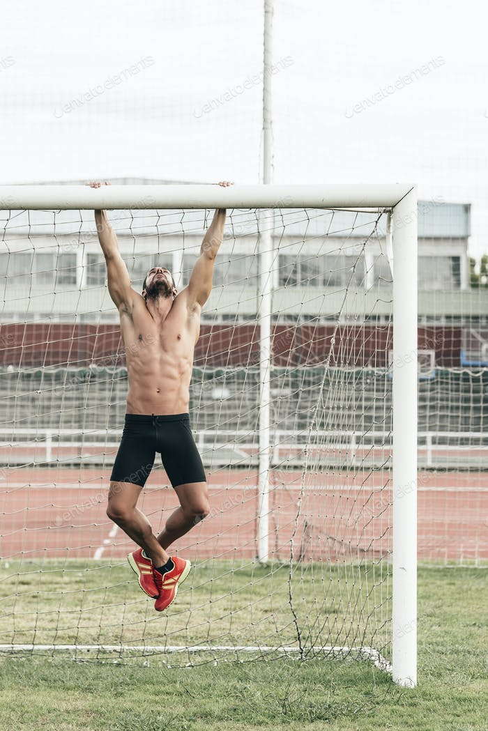 Man Doing Chin-ups outdoor.