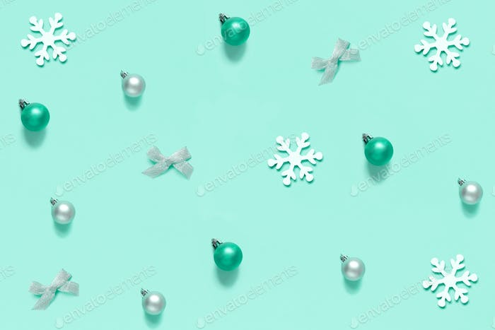 Christmas decorations on a light green background