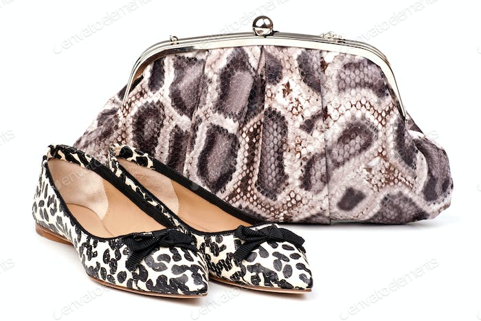 Pair of women summer shoes and clutch over white