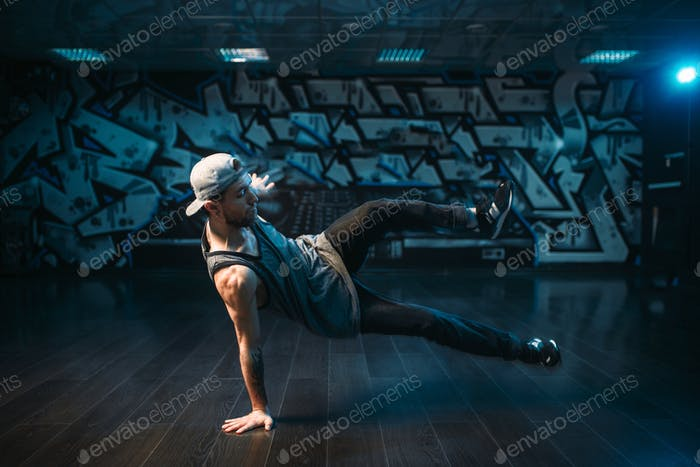 Young breakdance performer dancing in studio