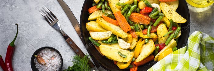 Roasted vegetables in black iron plate