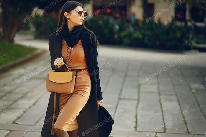 stylish girl walking through the city