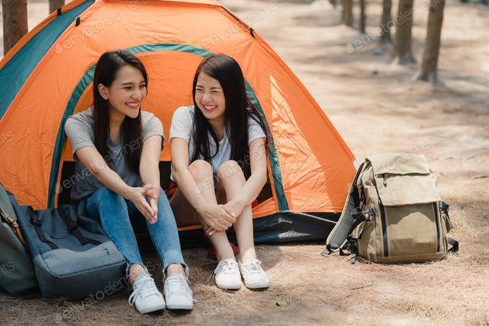 women couple camping or picnic together in forest, teenager female enjoy moment talking.