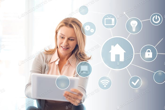 pretty blonde woman using digital tablet, smart home concept