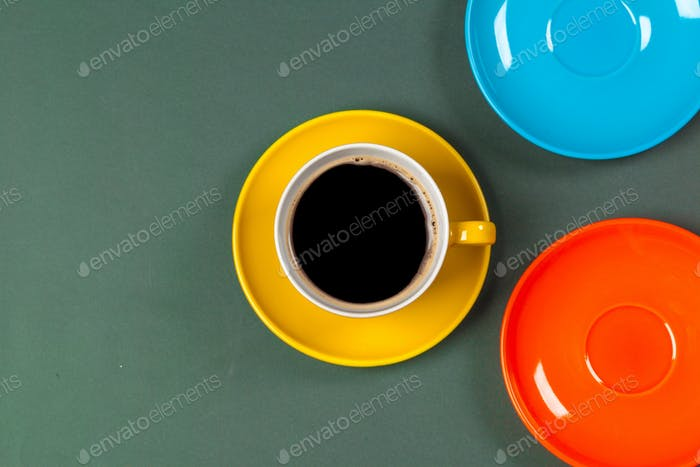 Bright colored coffee cup on a table top view