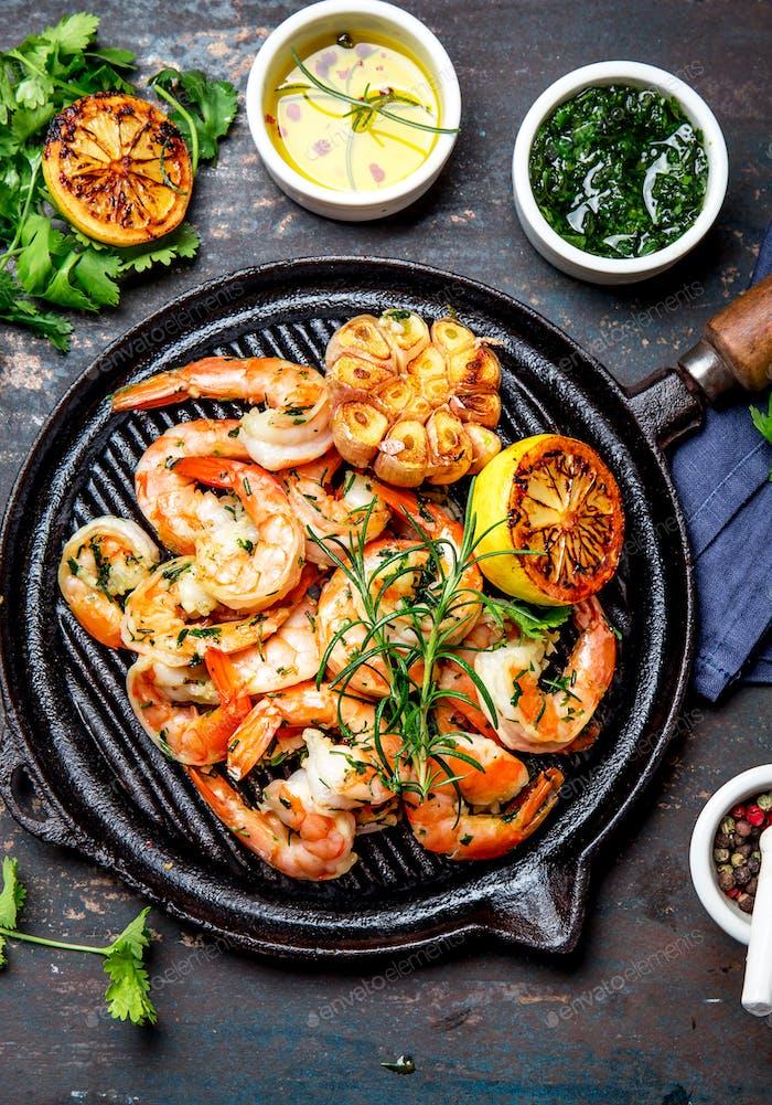 Grilled Shrimps Prawns on Vintage Grill Pan, Top View. Dark Background.