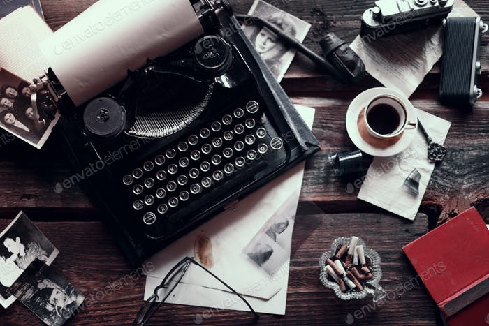 Thumbnail for Retro typewriter on a wooden table with different vintage things