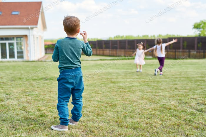 Group of Children Playing in Front Yard