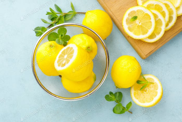 Sliced and whole lemons with mint