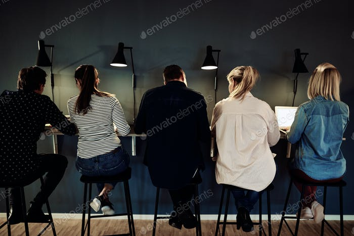 Group of businesspeople working late in an office together