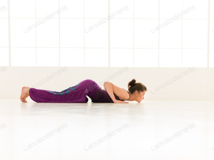 demonstration of difficult yoga posture