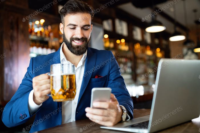 Young business man having a break in a restaurant. Work occupation business lifestyle concept
