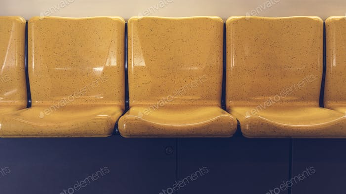 A row of yellow seats