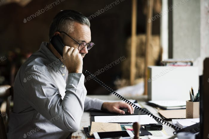 Businesspeople Answering the Phone Call