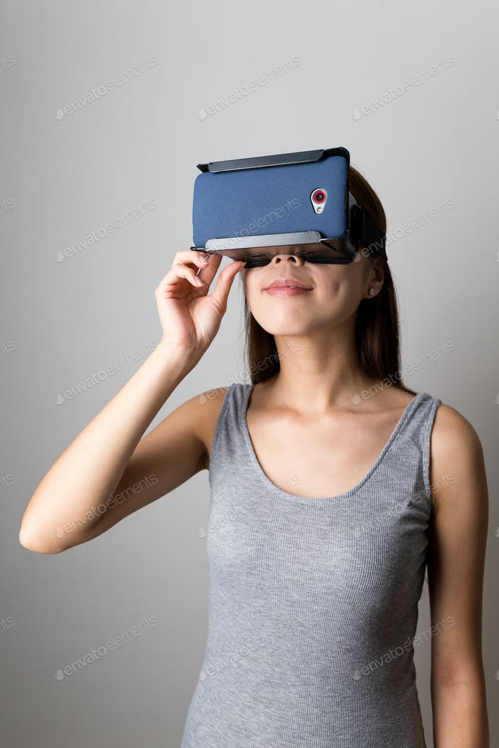 Young Woman watching the film with vr device