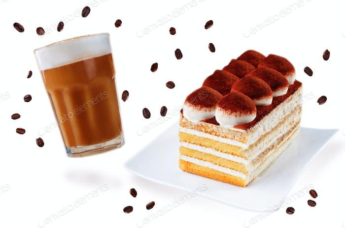 Tiramisu cake on a white plate with glass of cofee isolated