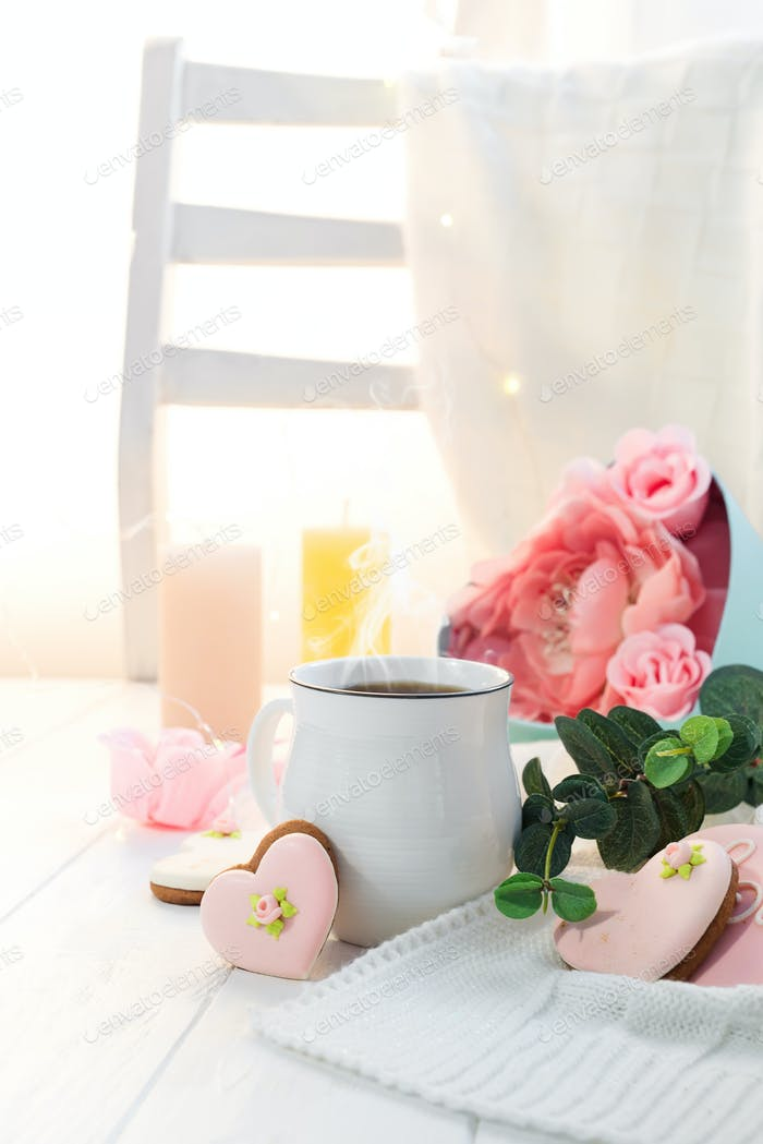 romantic breakfast in bed. Coffee , cookies ,gift box and flower on wooden table. Valentine's