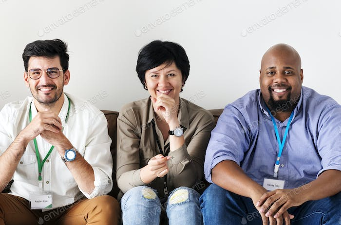 Diverse workers sitting together on couch
