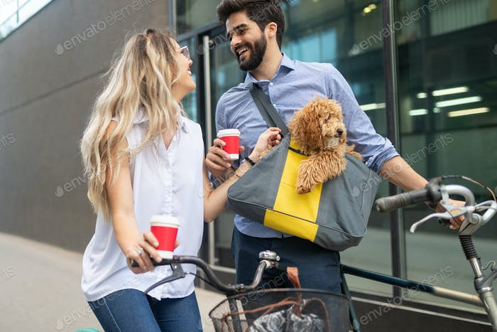 Romantic couple is having rest in the city with dog and bicycles
