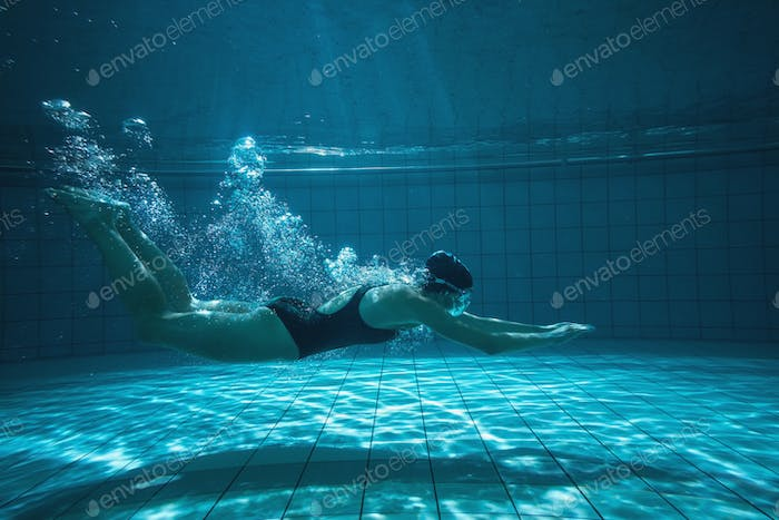 Thumbnail for Athletic swimmer training on her own in the swimming pool at the leisure centre