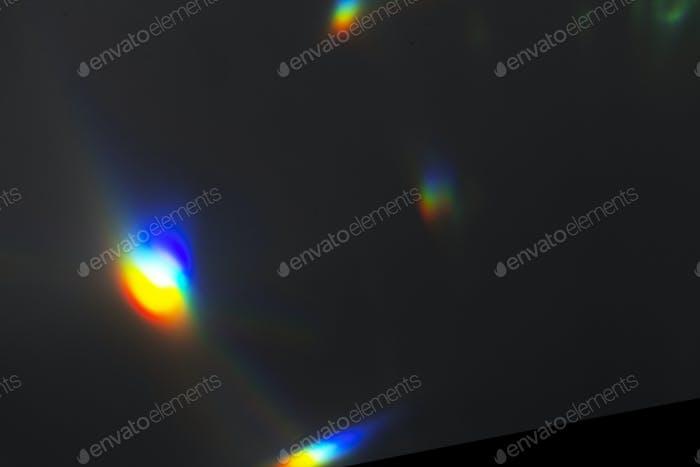 Light leak effect on a black background wallpaper
