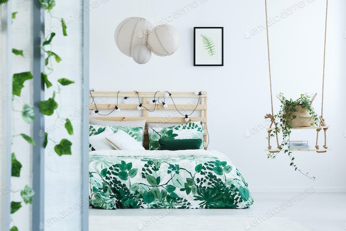 Botanical bedroom with wooden bed
