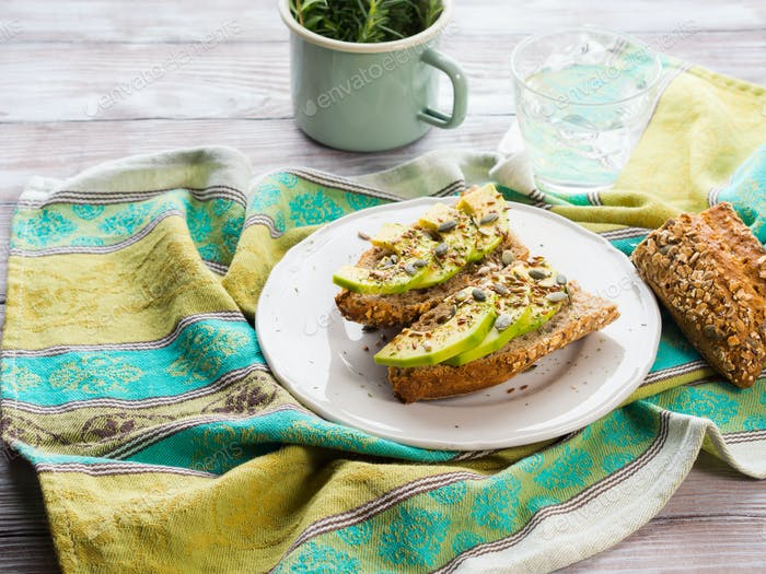 Avocado sandwich for healthy snack with seeds