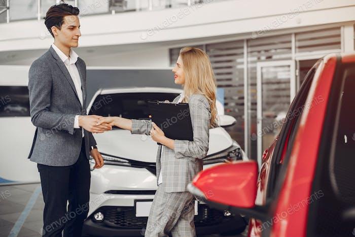 Two stylish woman in a car salon
