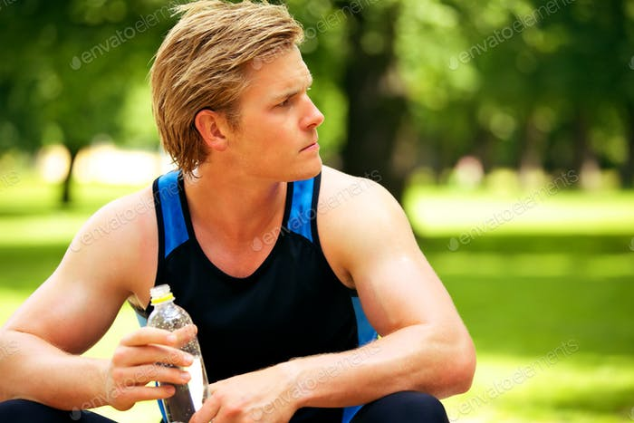 Athlete Holding a Water Bottle