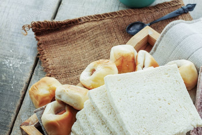 Various breads on wooden floor