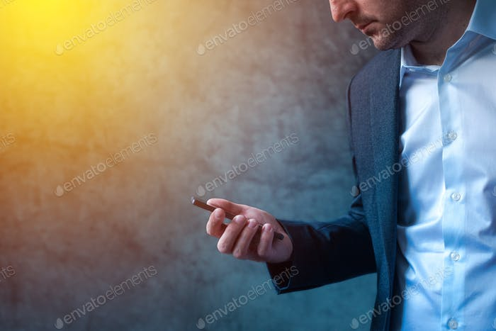 Businessman in hurry received SMS message on smartphone