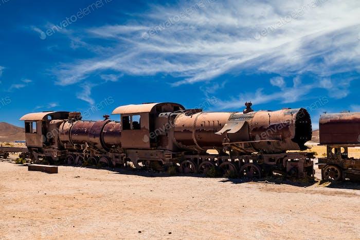 Old rusty locomotive abandoned in the train cemetery of Uyuni, Bolivia