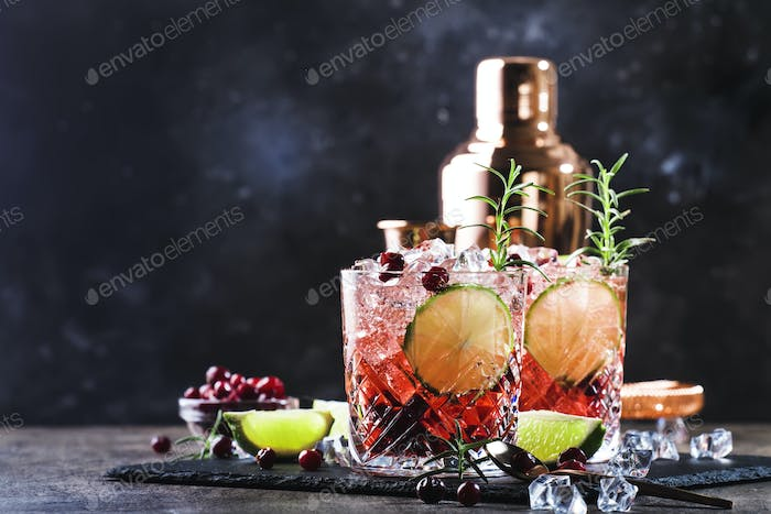 cocktail with rosemary, cranberries, vodka