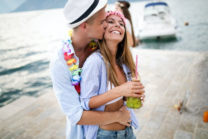 Couple of lovers hugging on the beach party on summer vacation