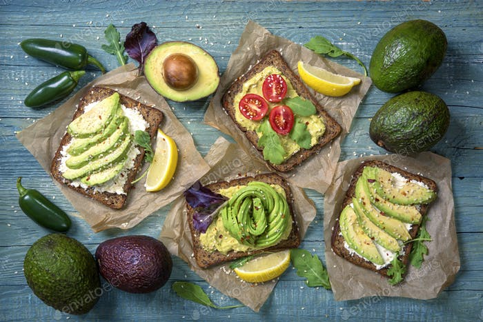 Sandwiches with rye bread and guacamole