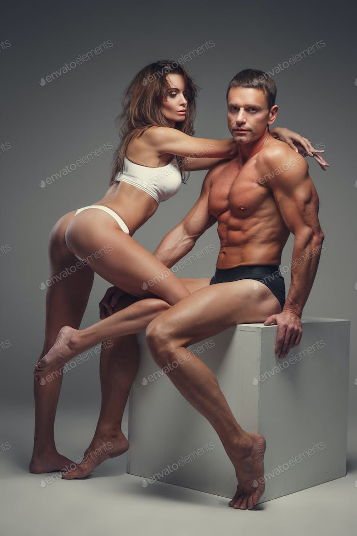 Middle age man and a woman in underwear.