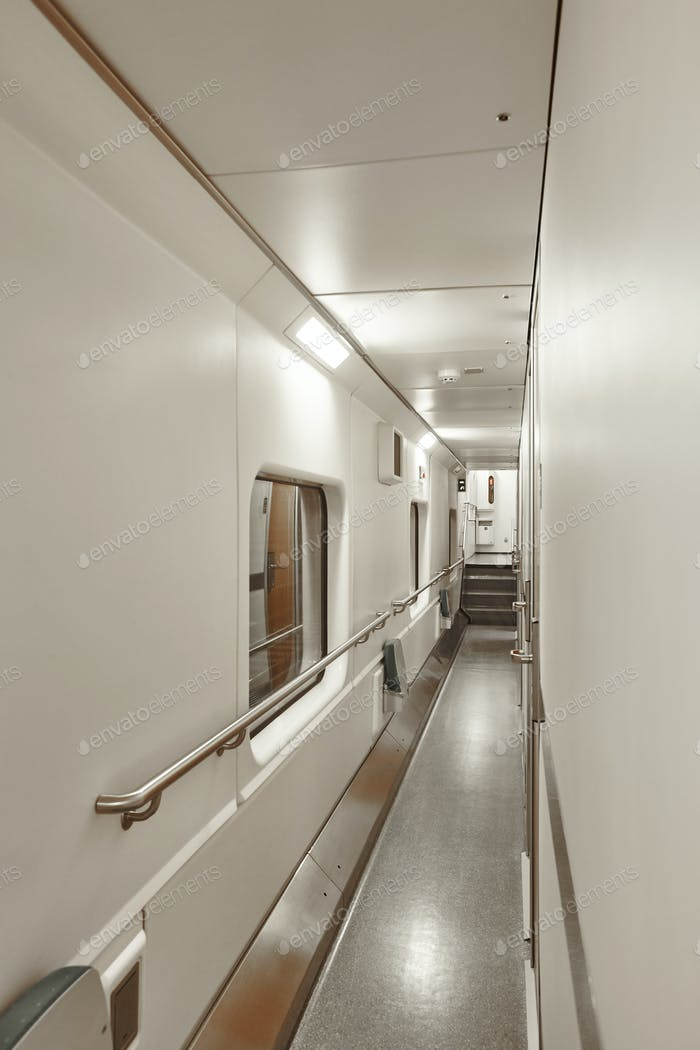 Sleeper wagon train corridor indoor. First floor. Transportation service. Vertical