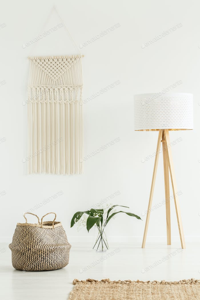 Peaceful zen living room interior with jute decorations, tripod