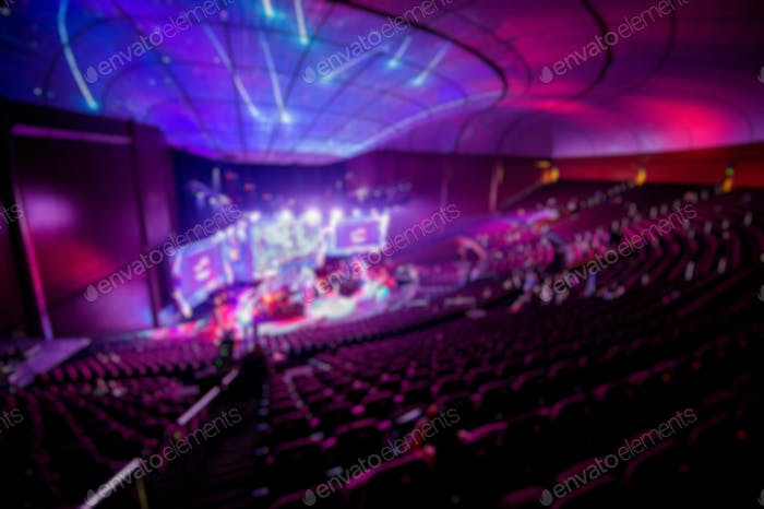 Abstract blurred background of big esports gaming event at big arena