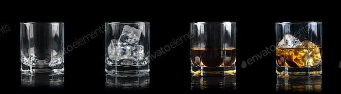 Set mit vier Gläsern für alkoholische Getränke auf schwarzem Hintergrund