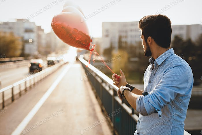 Sad man waiting for date on valentine date