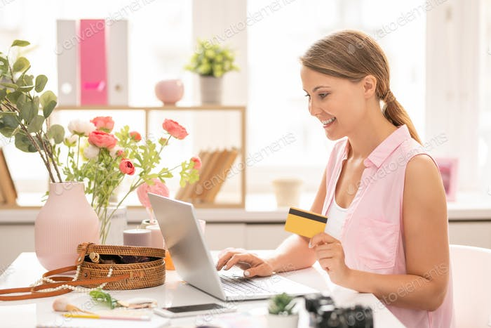 Young consumer entering personal data to pay for order in online shop
