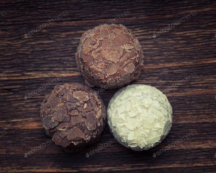 Milk chocolate,white chocolate and dark chocolate truffles place