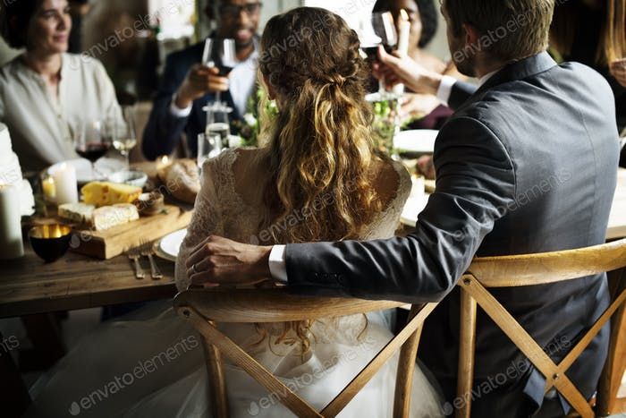 Bride and Groom Having Meal with Friends at Wedding Reception